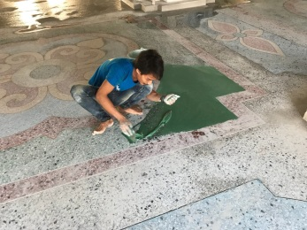 Decorating the floors at the new temple